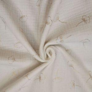 estampado de la flor de algodón en dorado sobre fondo blanco.