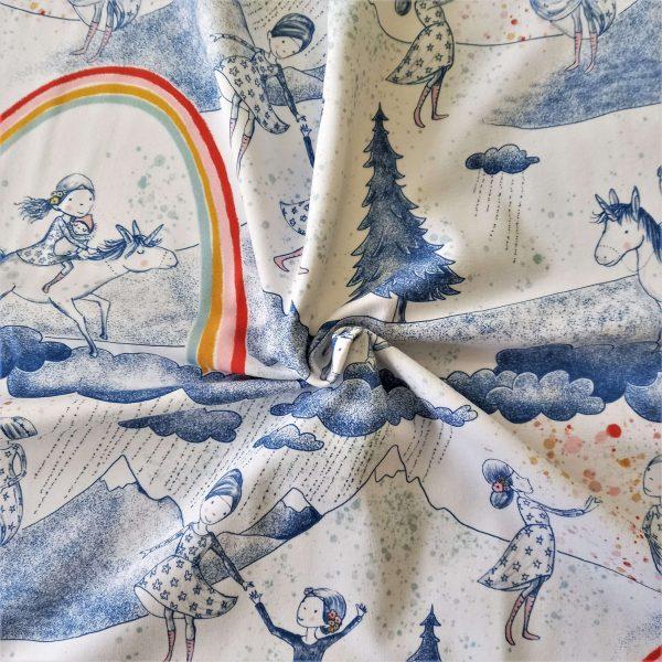Estampado de arcoíris y unicornios. Dibujos de mujer y niña