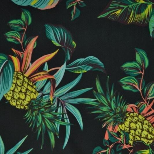 fondo negro con estampado de piñas y hojas